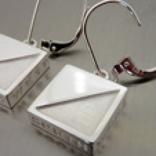 pair of orienteering  earrings silver